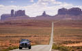 Dodge Ram Pickup driving on HWY 163 Monument Valley Arizona USA